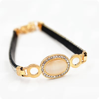 Cats Eye Bracelets, Zinc Alloy, with PU & Cats Eye, with 2lnch extender chain, gold color plated, for woman & with rhinestone, Length:Approx 6.3 Inch, Sold By Strand